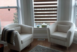 Comfy chairs by the window so we can discuss your well-being since your last session.
