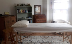 Hop up onto the massage table when it is time for your energy medicine session.